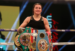 Katie Taylor with her world title belts. Photo: Sportsfile