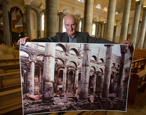 Tiernan Dolan with a photo he took of damage caused to St Mel's when it went up in flames