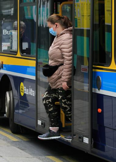 A passenger wearing a face mask on public transport in the city centre yesterday