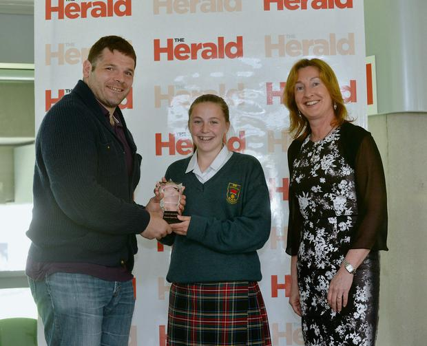 Claire Grady, editor of The Herald, and Leinster rugby player Mike Ross presents The Herald School Sports Star of the Future 2013 award to Eleanor Ryan Doyle, from St Joseph's College Lucan. Photo: Caroline Quinn