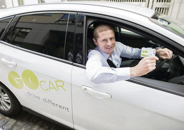 ON THE ROAD: Reporter Cormac Murphy with GoCar.