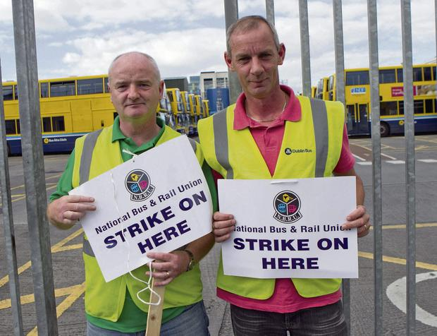 DETERMINED: Alan Perry and Robert Cloake at Ringsend bus depot in Dublin