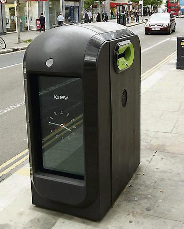 A rubbish bin equipped with television screens showing public information, near to St Paul's Cathedral in the City of London. Photo: PA/Sean Dempsey