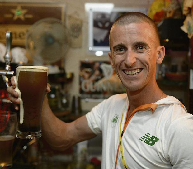 Rob enjoys a pint in Moscow after his win. Photo: Sportsfile