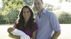 William and Kate with baby George. Photo: Reuters