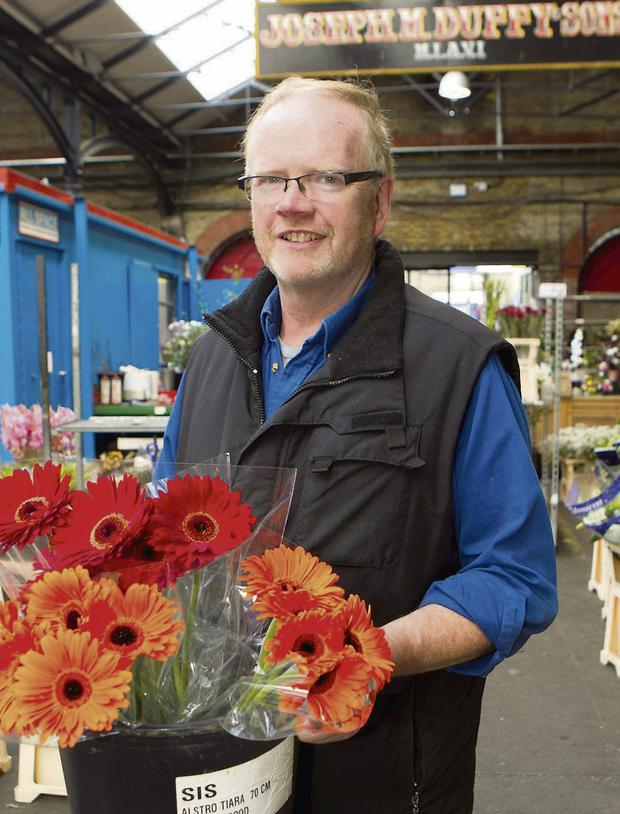 Joe Duffy at work in the Fruit and Flower Market in Dublin. Photo: Kyran O'Brien