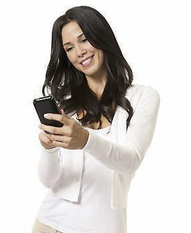 Young woman texting with mobile phone