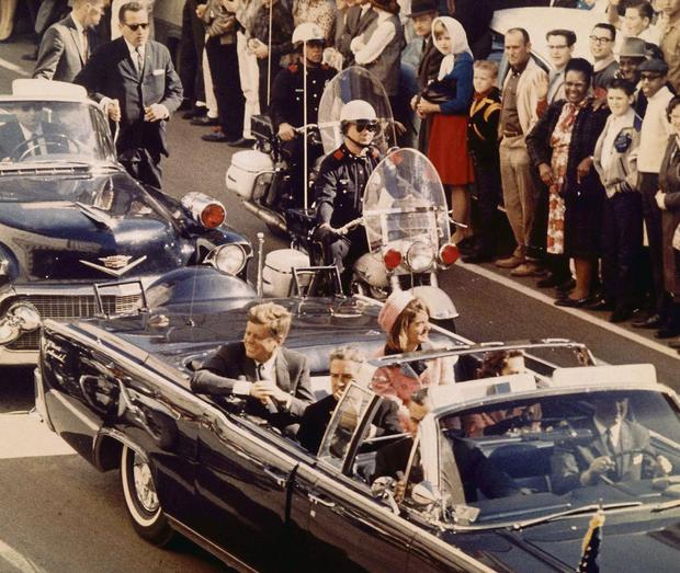 OMINOUS: President John F Kennedy and his wife Jackie (left) just before he was shot.
