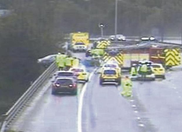 ROAD DRAMA: Two people were rescued after their car was left hanging off the M6 motorway near Merseyside