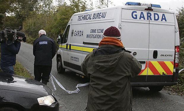 Gardai at the scene in Clonee where body parts of Christopher Gaffney were found. Photo: Collins