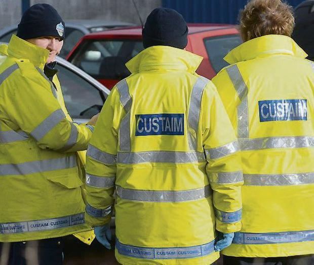 Gardai and Customs officers during search of business grounds on R132 opposite M1 Business Park, north Dublin. Picture: Caorline Quinn