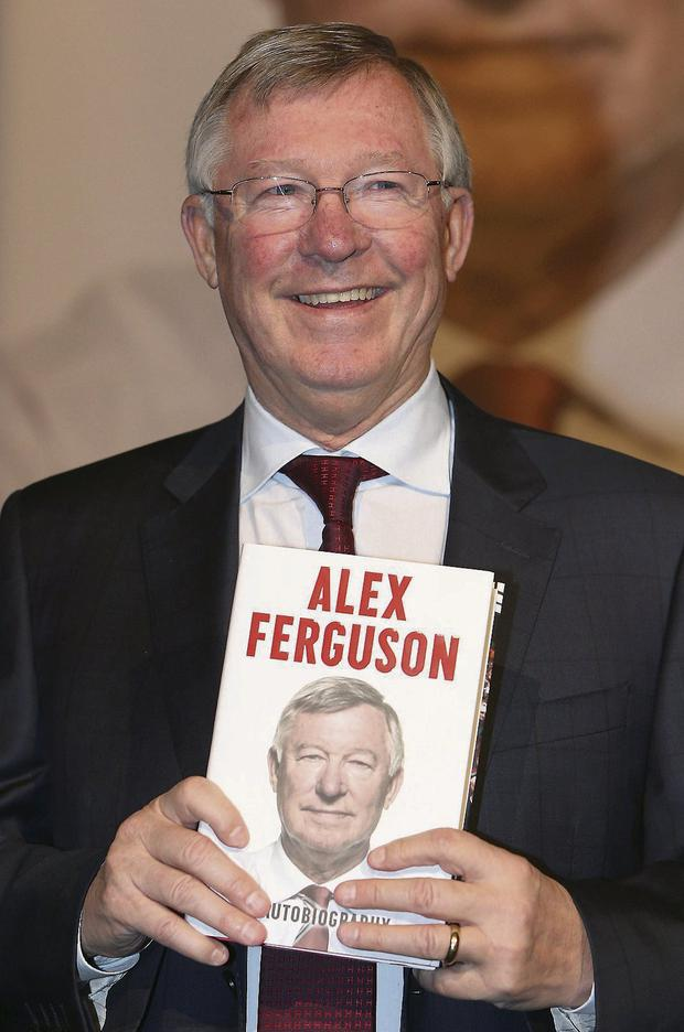 RED KNIGHT: Sir Alex Ferguson addressed a crowd of 2,500 United fans (right) as he promoted his memoirs