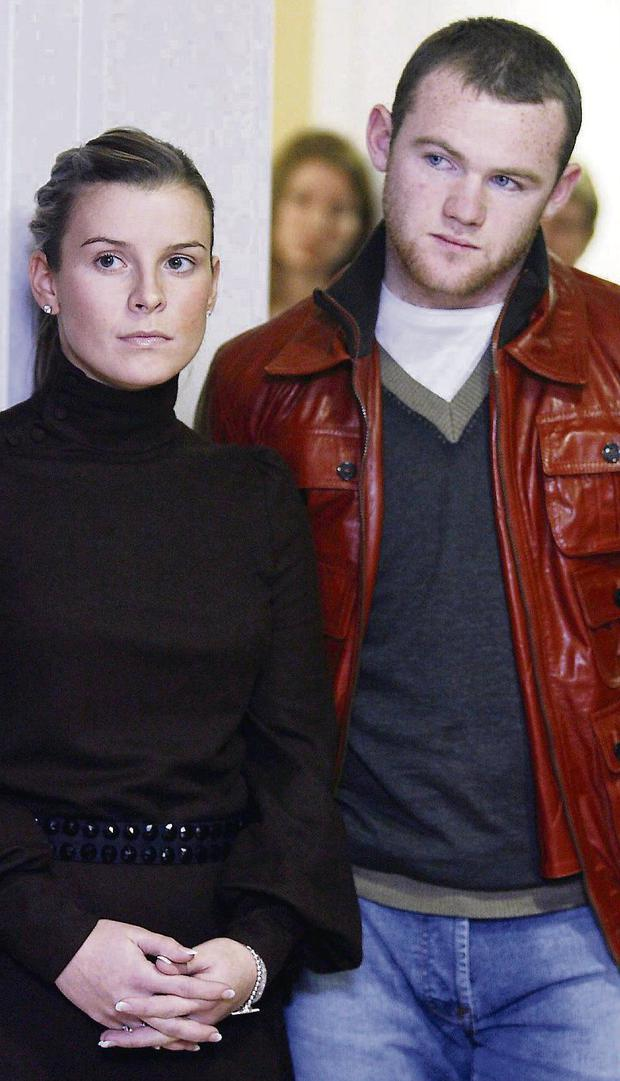 CLAIMS: Wayne Rooney and his wife Coleen, left