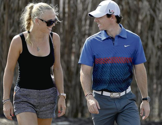 Together: Caroline and Rory at golf tournament in Dubai. Photo: Getty Images