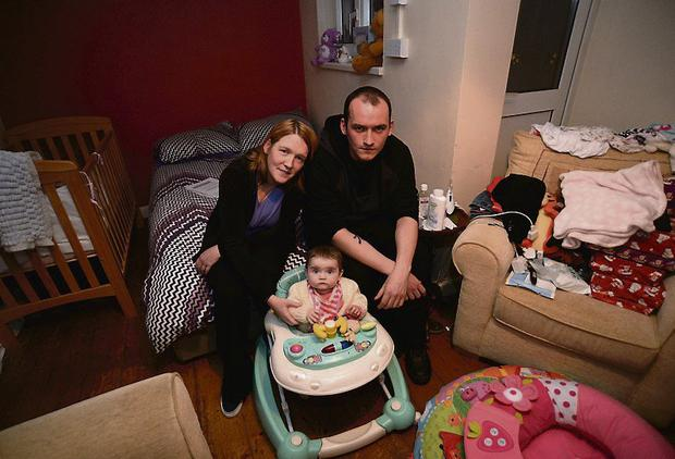 Frustration: Annmarie Gannon with partner Joe Dunne and daughter Ellie in cramped flat in Drimnagh. Photo: Caroline Quinn