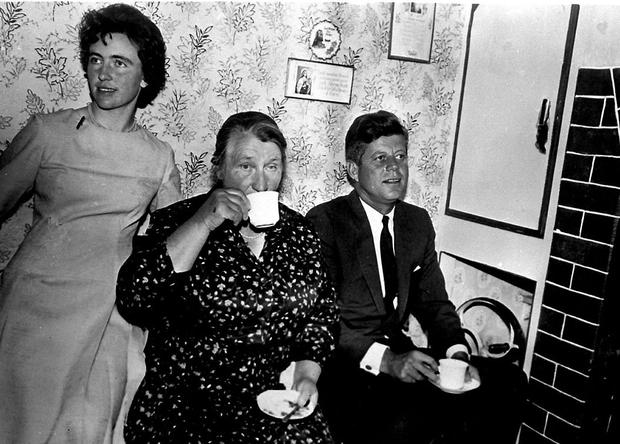 Homestead: JFK having tea with his host and second cousin Mary Ryan (centre) and her daughter Josephine Ryan. Photo: PA