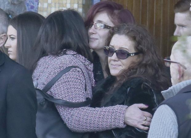 IN LOVING MEMORY: Mourners at Michael Gannon's funeral yesterday.