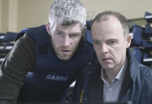 Det Garda Kieran O'Reilly (left) and Brian O'Byrne in scene from show.