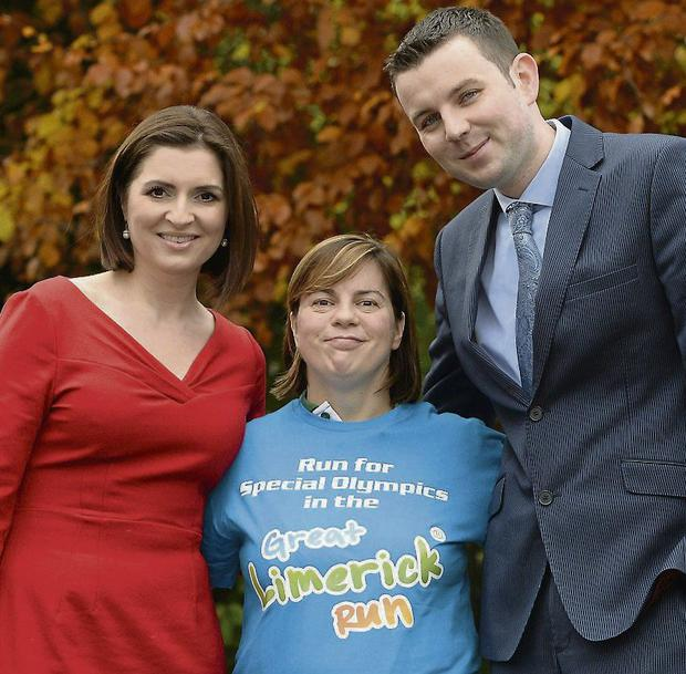 BACKING: Collette and Chris with athlete Christine Delaney