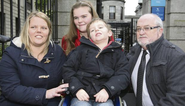 RELIEF: Dylan Gaffney Hayes (centre) with parents Jean Gaffney and Thomas Hayes and older sister Shauna