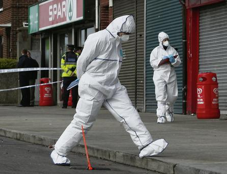 Evidence: Gardai examine the scene where Jay Saunders died