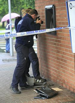 SCENE: Gardai search for clues. Photo: Gareth Chaney/ Collins