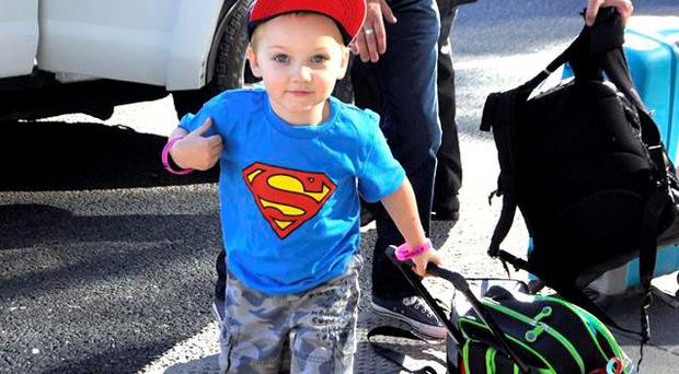 Super Hero Gavin Glynn and his dad John as they arrived in Dublin airport .