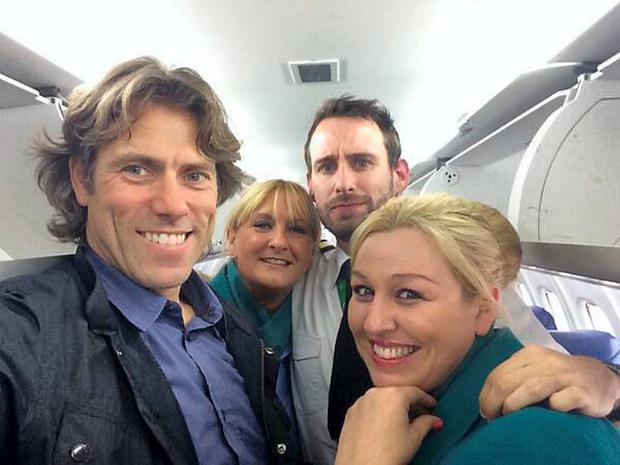 Comedian John Bishop poses with Aer Lingus cabin crew
