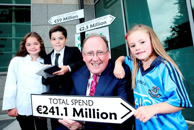 Bonnie Conlon (9), from St Margarets; Evan Wilkes (9), from Artane; Martin Kelleher, managing director of Centra, and Hannah Mahony (7), from Swords. Photo: Maxwells