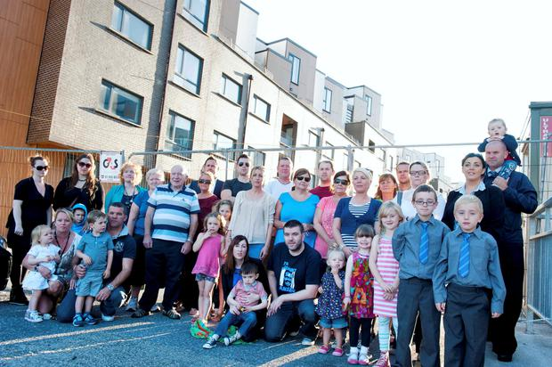 Former residents of Priory Hall outside the building. Photo: El Keegan