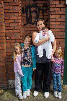 The Moloney family are homeless. Megan (6), Chantelle (8), Michelle (mom), Maise (2 months) and Alisha (4).