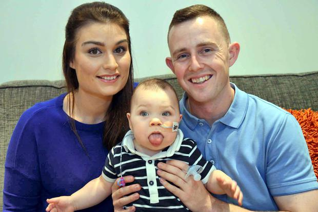 Noah Drake Brennan who suffers from Beckwith Wiedemann Syndrome pictured with his parents Emma and Philip at their home in Castle Heights, Carrigaline