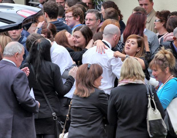 Family members are consoled as the remains of wheelchair bound David Costigan who died in a suspected arson attack on his home in Bray, Co. Wicklow last week are carried by family members from St. Fergal's Church, Ballywaltrim, Bray Photo: Colin Keegan, Collins Dublin.