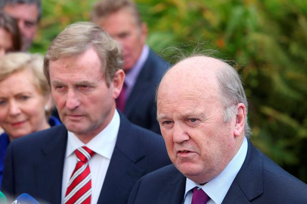 Finance Minister Michael Noonan backed embattled Taoiseach Enda Kenny