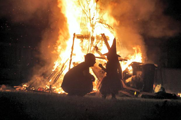 Locals enjoy bonfires on Halloween night at Ballymun, Dublin