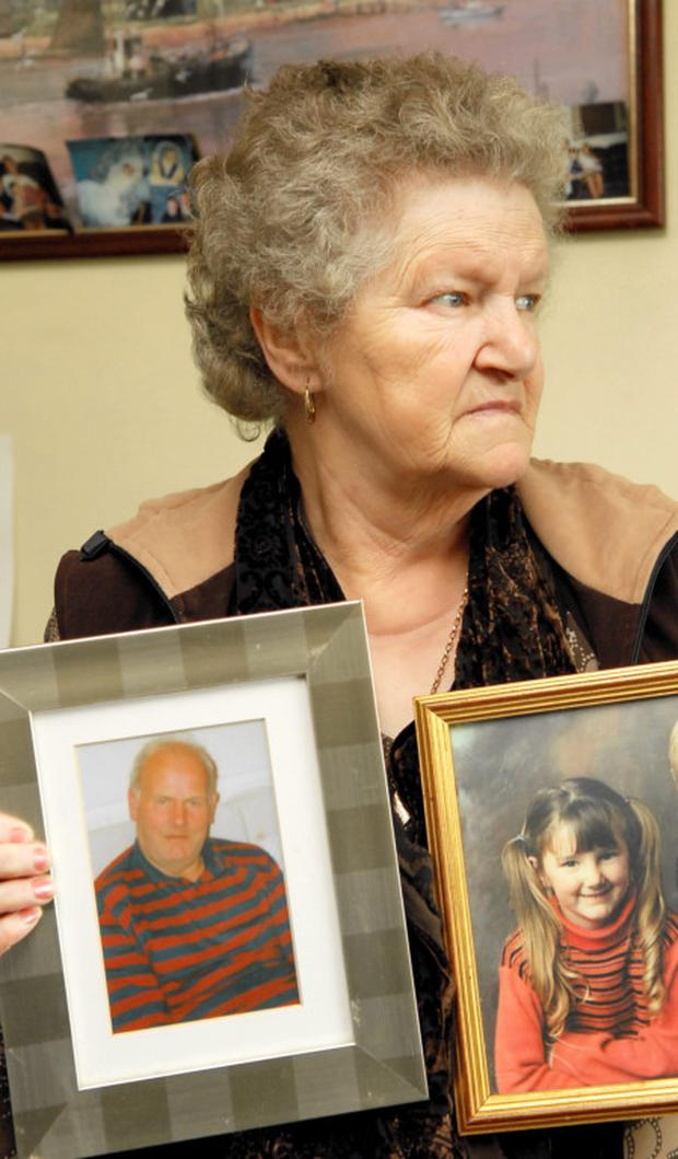 Ann Boyle, whose daughter Mary went missing 30 years ago this March 18th. Ann is holding a photo of Mary and her late husband Charlie.