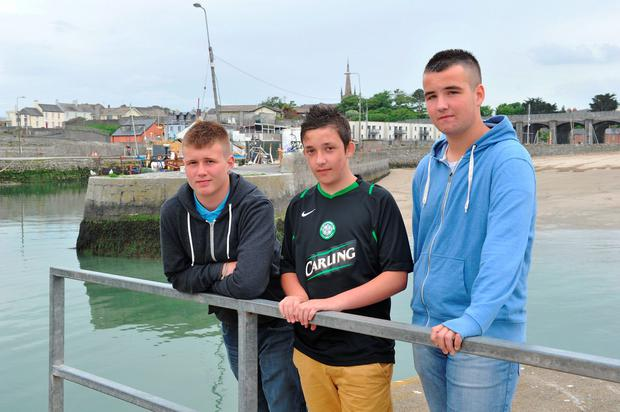 David Grant, Ben Graham and Alex May pictured at Balbriggan Harbour where they rescued a teenage girl who was lying face down in the sea. Picture Ciara Wilkinson.