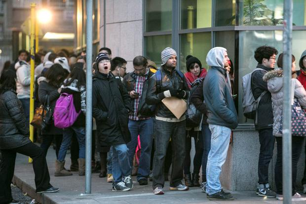 People waiting outside the offices of the Irish Naturalisation and Immigration Service Burgh Quay.