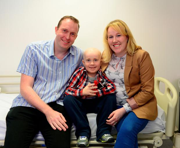 Daniel is pictured with his parents Brian and Caroline