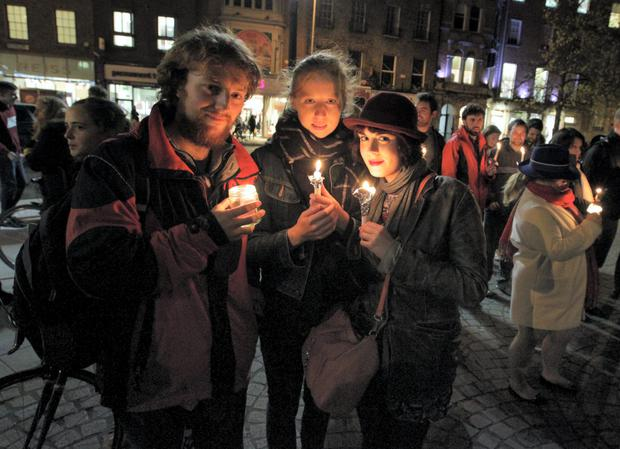 John Tighe, April Scully and Dearbhla Quinn pictured at the Candlelight Vigil in Remembrance of Savita Halappanavar at St Stephen's Green