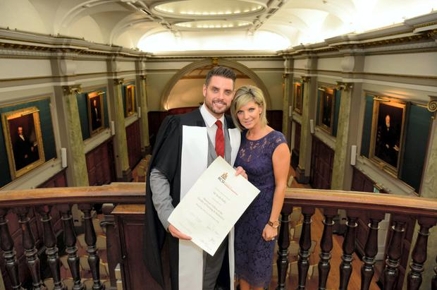 Keith Duffy with his wife Lisa as he celebrates the award of an Honorary Fellowship from the RCSI