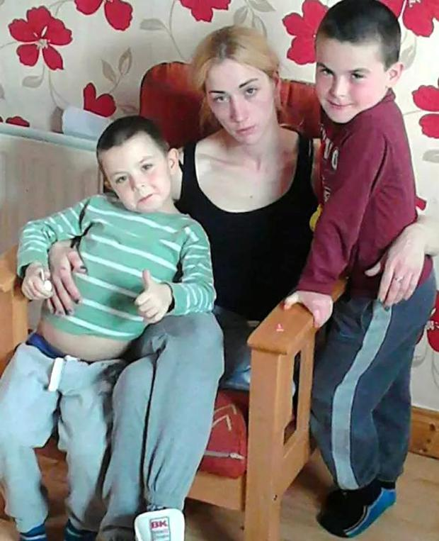 Helen Lynch, who is homeless and from Tullamore, Co Offaly, with Charlie (on left) and her eldest son Daniel (7) (on right).