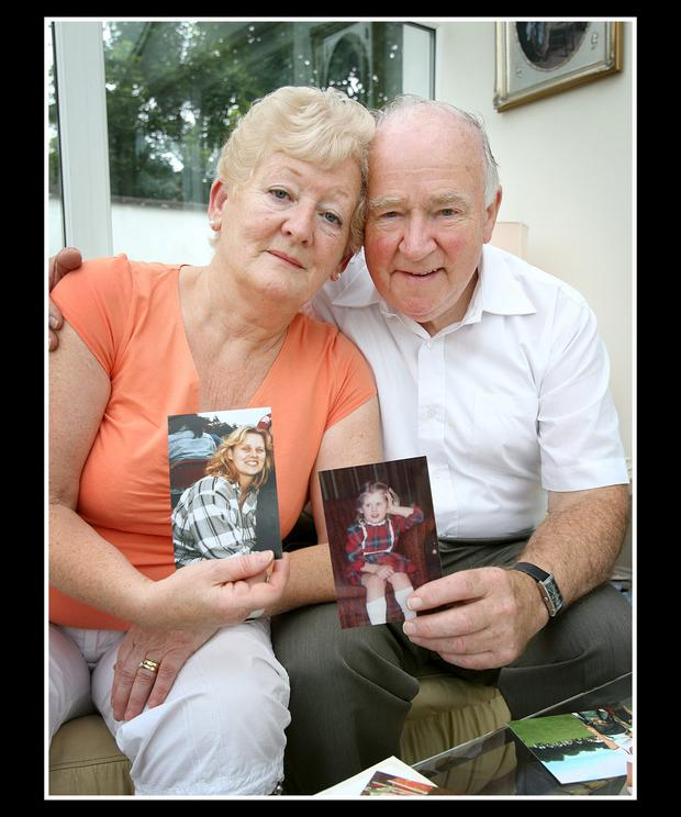 Rose and Jim Callaly pictured with favourite pictures of their daughter Rachel, at their home in Dublin.