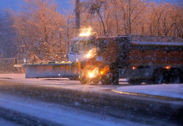 A snow plough waits for the snow to settle in Near blizzard conditions in Lucan, Co. Dublin