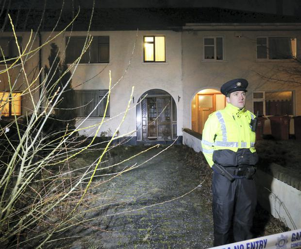 A Garda on duty at The Glendhu Road, Cabra house where a body was discovered