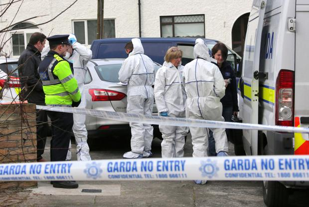 Gardai and State Pathologist, Dr. Marie Cassidy pictured at the scene where the body of a man in his 40's was found in a house on Glendu Rd. Cabra