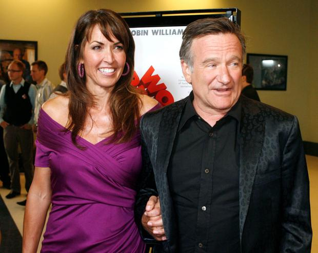 Actor Robin Williams and his wife Susan Schneider (L)