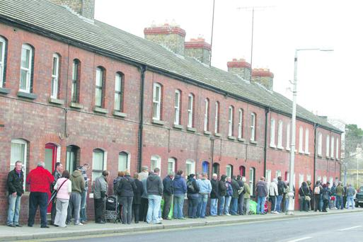 Dole Queue. People queue down Cumberland Street, Dun Laoghaire to collect their social welfare payments.