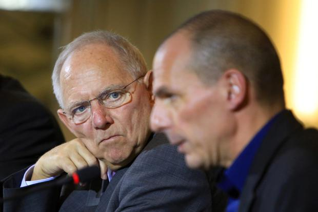 Wolfgang Schaeuble, Germany's finance minister, left, looks towards Yanis Varoufakis, Greece's finance minister, during a news conference at the Chancellery in Berlin,