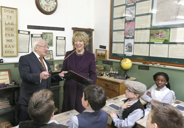 President, Michael D Higgins and his wife Sabina speak to 5th class students from St Brigids National School in Castleknock as they recreate a classroom from 1865 on the occasion of their 150th anniversary celebrations. Picture credit; Damien Eagers 10/2/2015